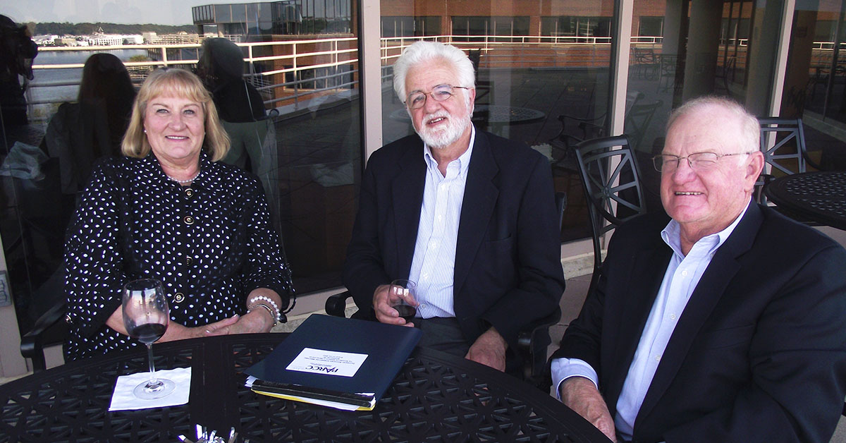 Jack McKay (right), along with his wife Roberta and former HumRRO President Laurie Wise.